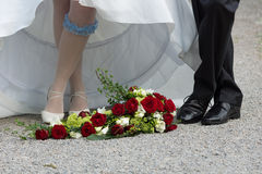 Feet of bride and bridegroom. Feet of a bride and a bridegroom royalty free stock images