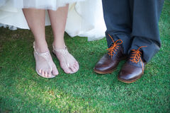 Feet of bride and groom Stock Image