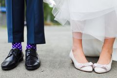 Feet of bride and groom stock images