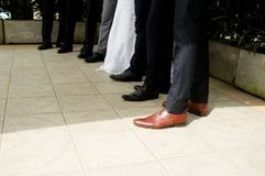 Feet of the bride and groom and his groomsmen royalty free stock images