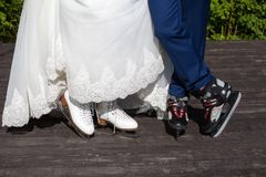 Feet of the bride and groom ice skating. stock image