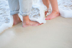The feet of the bride and the groom playing Royalty Free Stock Photography