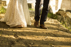 Feet of bride and groom walking, wedding shoes (soft focus). Cro. Ss processed image for vintage look Royalty Free Stock Photos