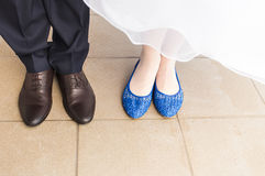 Feet of bride and groom, wedding shoes close-up.  Stock Image