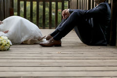 Feet of bride and groom, wedding shoes (soft focus). Cross proce. Ssed image for vintage look Stock Photos