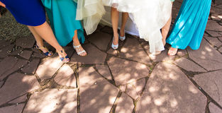 Feet of a bride and her bridesmaids Royalty Free Stock Image