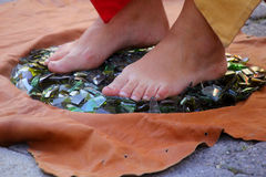 Feet on broken glasses. In the street Royalty Free Stock Photos