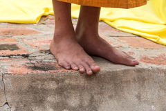 Feet of buddhist monk Royalty Free Stock Photo