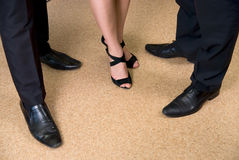 Feet of business people standing on the floor Royalty Free Stock Image