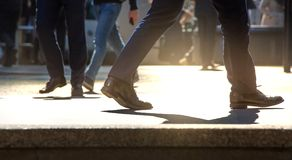 Feet of business people walking in the City of London. Busy modern life concept. Royalty Free Stock Image