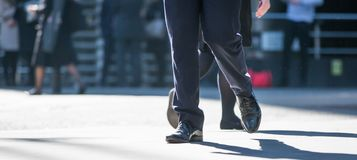 Feet of business people walking in the City of London. Busy modern life concept. Royalty Free Stock Photography