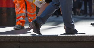 Feet of business people walking in the City of London. Busy modern life concept. Stock Image