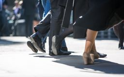 Feet of business people walking in the City of London. Busy modern life concept. London, UK - March 15, 2017: Feet of business people walking in the City of Royalty Free Stock Photos