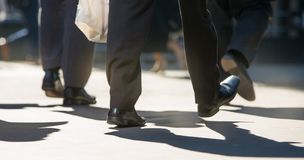 Feet of business people walking in the City of London. Busy modern life concept. Royalty Free Stock Photo