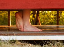 Feet in a cabana Royalty Free Stock Photo