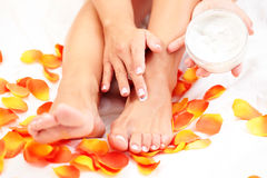 Feet care in bed royalty free stock photography