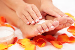 Feet care in bed Royalty Free Stock Image