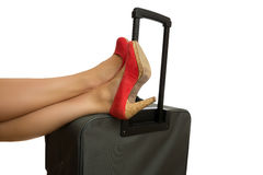 Feet on case. With red high heels on Royalty Free Stock Images