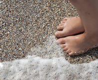 Feet of child on the beach. Two child feet on the beach stock photo