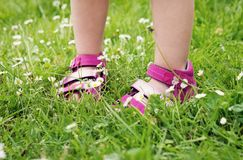 Feet of child girl in grass Royalty Free Stock Photos