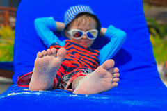 Feet of child relaxed and enjoying summer beach Royalty Free Stock Photo