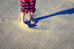 Feet of a child on sand beach Royalty Free Stock Photo