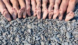 The feet of children on the beach. Stock Photos
