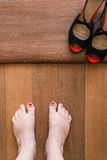 Feet with chipped nailpolish and black shoes Stock Photos