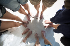 Feet in a circle. Feet of young man and women of a clique in a circle Royalty Free Stock Photography
