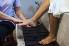 Feet clean before massaging Tan girl royalty free stock images
