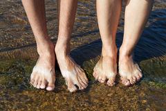Feet in the clear water Royalty Free Stock Images