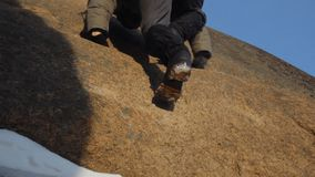 The feet of the climber in the mountaineering boots closeup. stock footage
