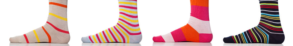 Feet close up wearing colorful socks. Isolated Royalty Free Stock Image