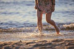 Feet closeup on beach on sunbed enjoying sun on sunny summer day. Stock Photography