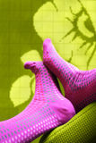 Feet with colored socks Stock Images
