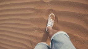 Feet come in the sand. Drought. The desert in the UAE. Sand dunes stock video footage