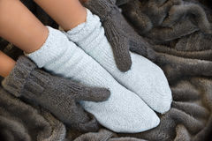 Feet in comfortable and warm woolen socks Stock Images