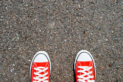Feet concept with red sneaker on black background with space for text or symbol. Royalty Free Stock Image