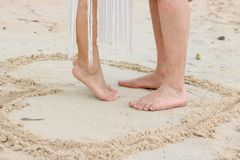 Feet of couple on the beach royalty free stock photo