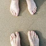 Feet of a couple at the beach Stock Photo