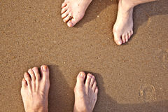 Feet of a couple at the beach Royalty Free Stock Images