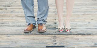 Feet of couple on boardwalk Royalty Free Stock Photography