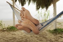 Feet Of Couple Relaxing In Hammock Stock Photo