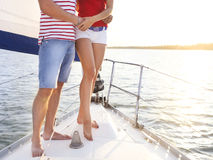Feet of a couple on sailboat deck in the sea Stock Photo