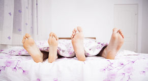 Feet of a couple sleeping side by side Royalty Free Stock Photography