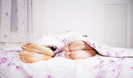 Feet of a couple sleeping side by side Stock Photo