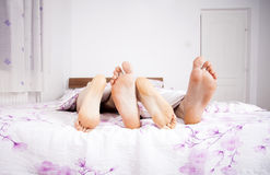 Feet of a couple sleeping side by side Royalty Free Stock Images