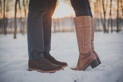 Feet of couple in snow Royalty Free Stock Images