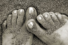 Feet covered with sand. Womans' feet covbered with sand stock photography