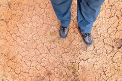 Feet on the cracked soil Stock Photography